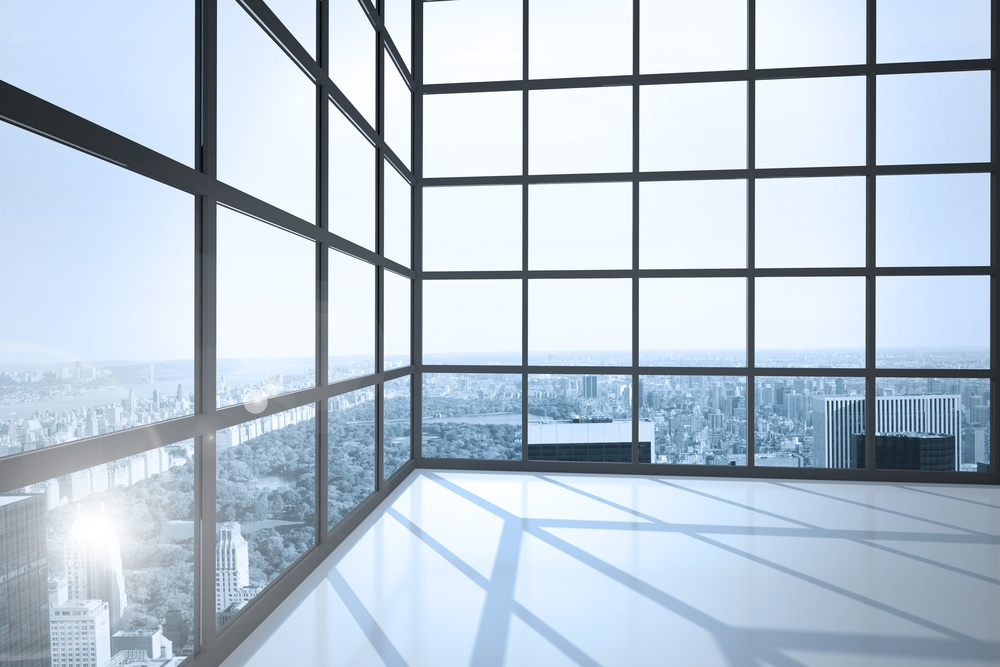 Room with large windows showing city.jpeg
